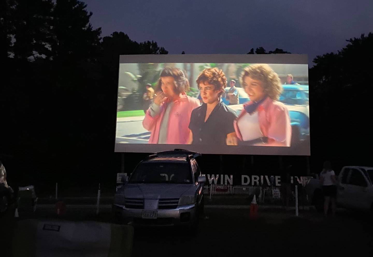 """A drive-in movie theatre shows """"Grease."""" Photo courtesy of Lucas Aho."""