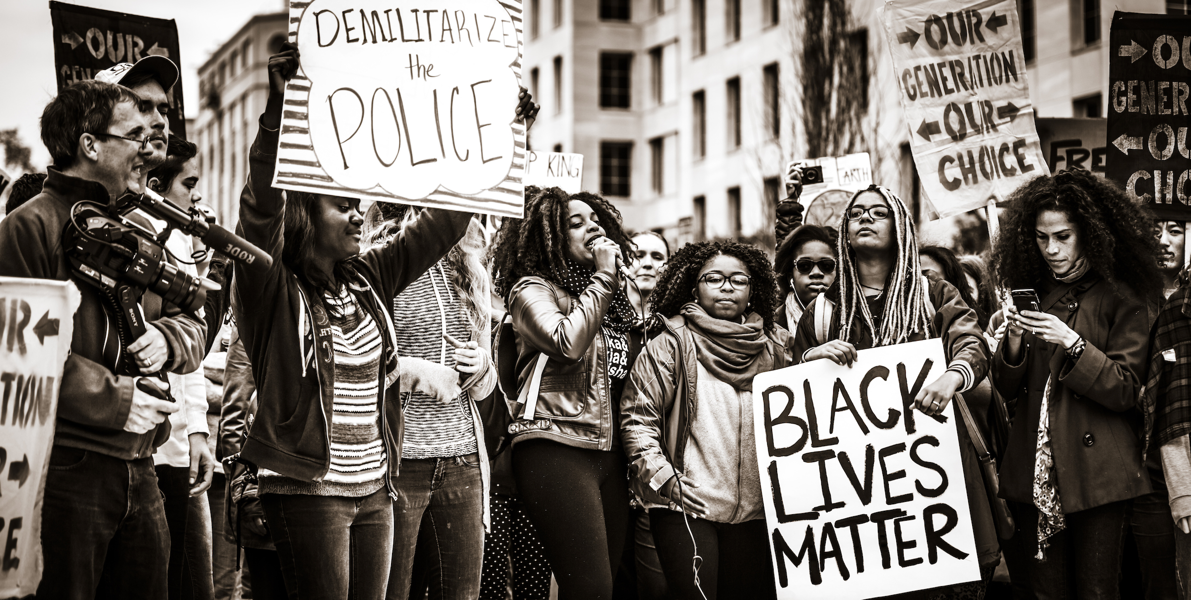 Black Lives Matter demonstrators at a protest hold signs in support of the cause. Photo courtesy of Johnny Silvercloud on Wikimedia Commons.