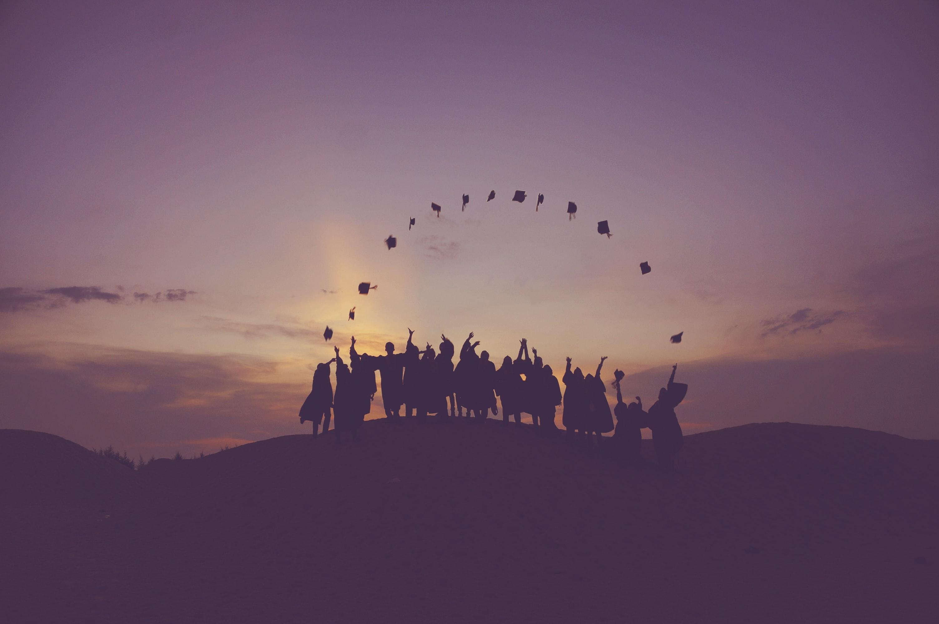 Graduates throw their caps in the air. Photo courtesy of Baim Hanif on Unsplash.