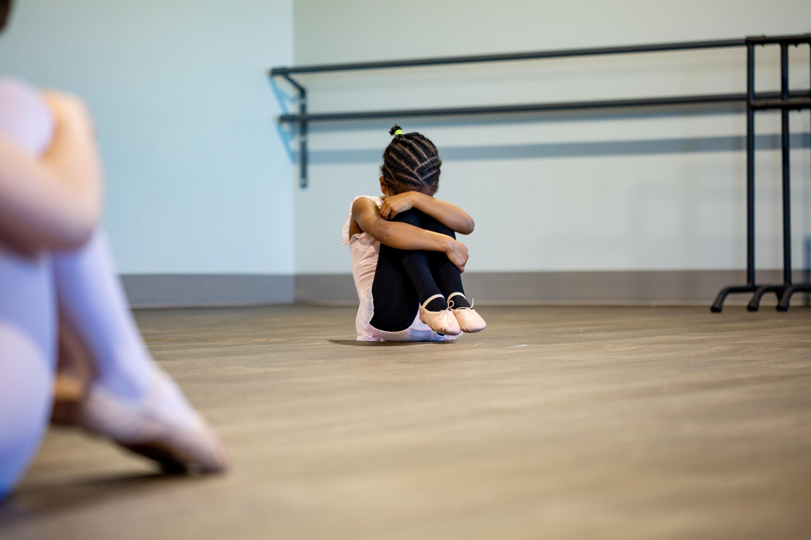 Young, anxious ballet dancer. Photo courtesy of Solen Feyissa via Unsplash