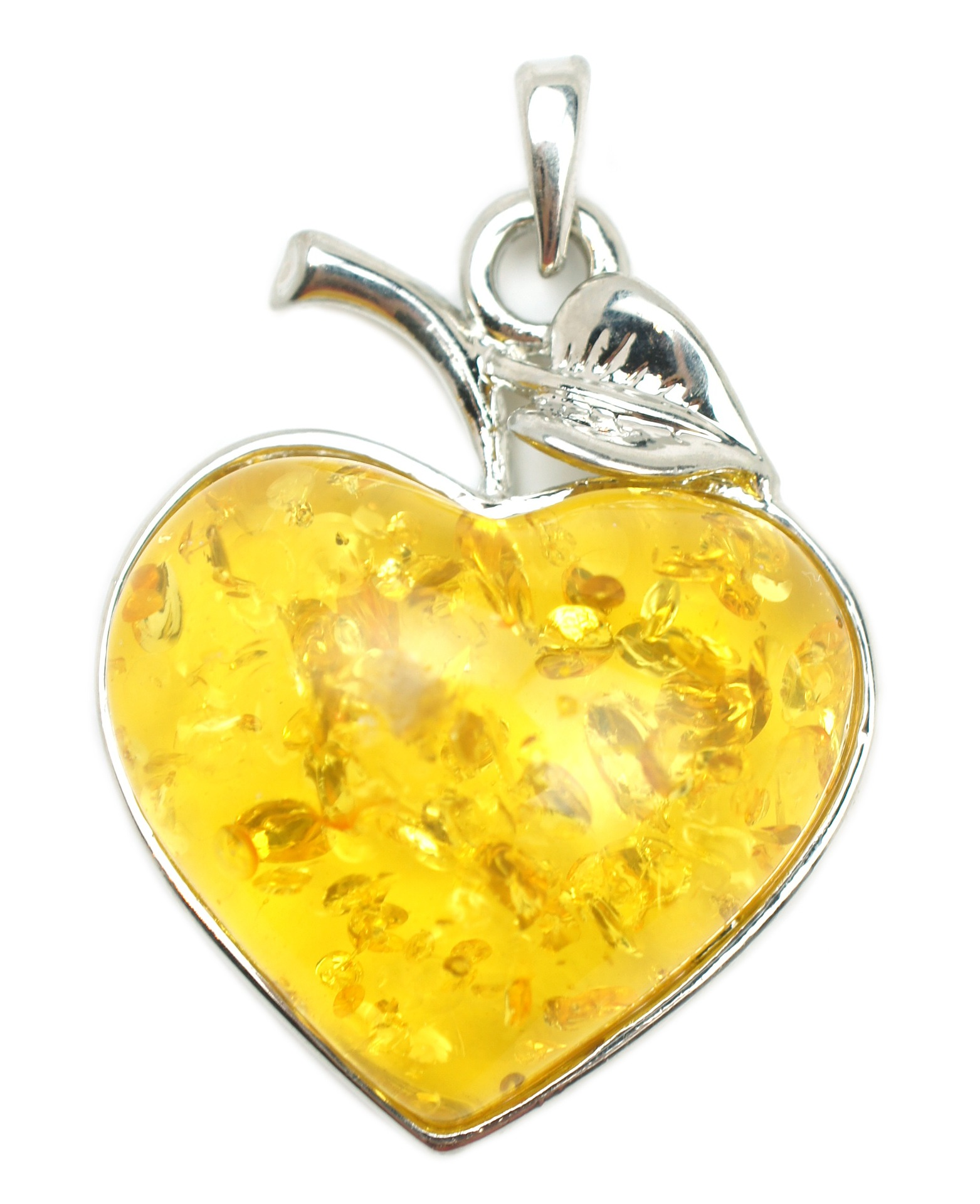 A yellow resin heart-shaped jewelry pendant. Photo courtesy of starbright on Pixabay.