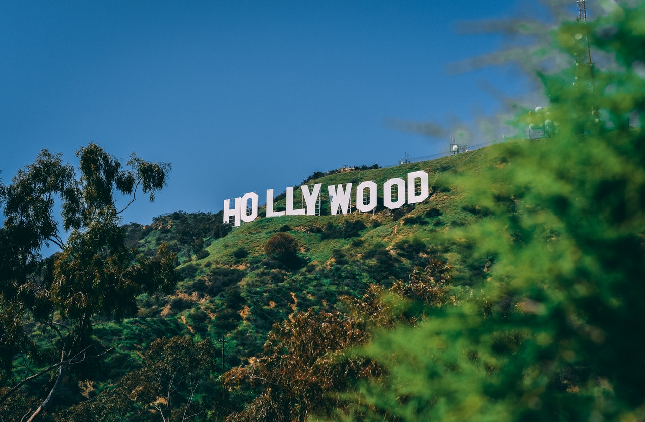 A photo of the Hollywood sign against blue sky. Photo courtesy of Paul Deetman on Pexels.