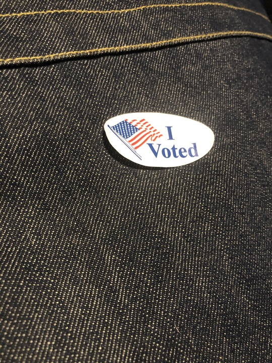 "An ""I Voted"" sticker on denim. Photo courtesy of the author."