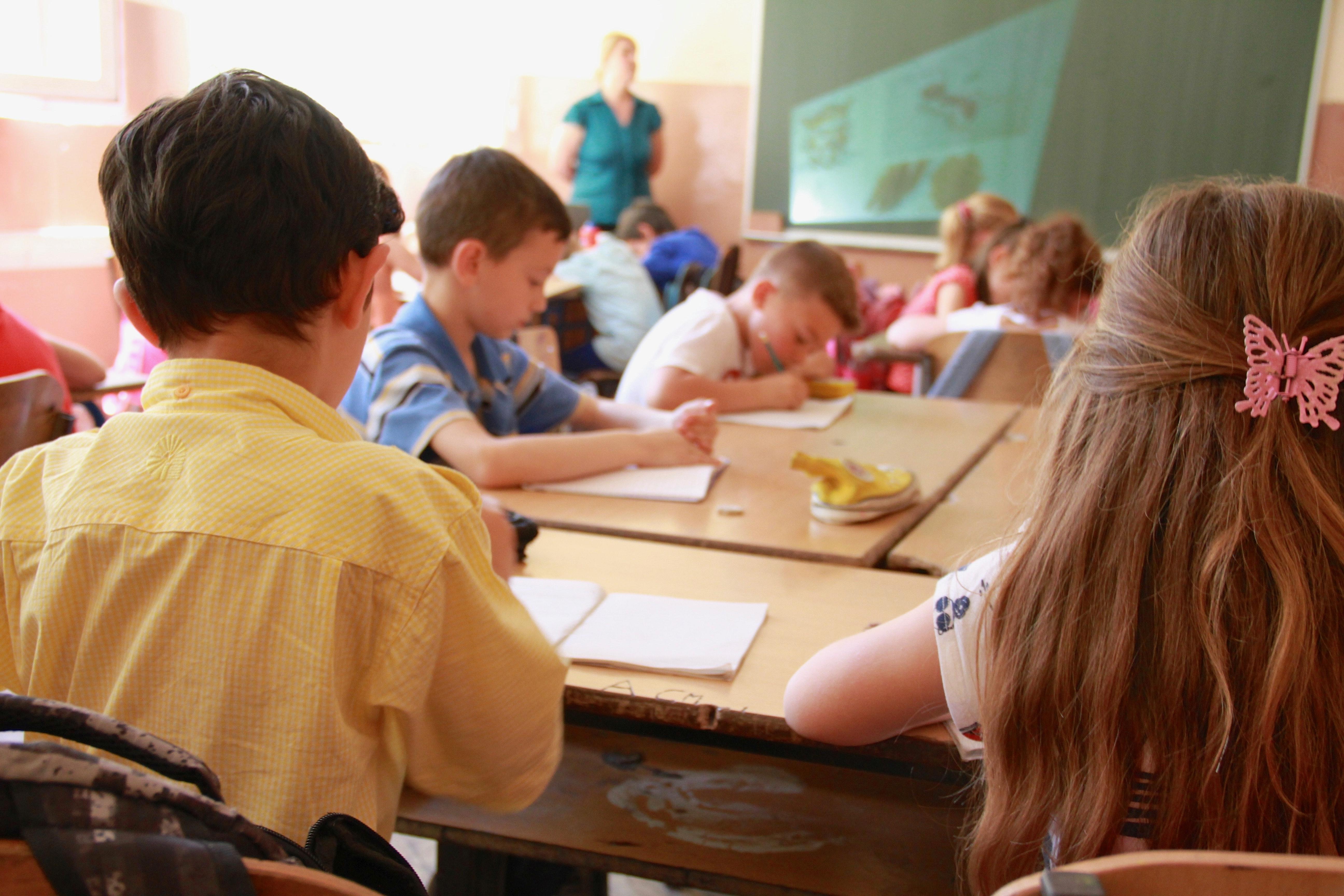 Children sitting in a classroom. Photo courtesy of Megan Soule via Unsplash.