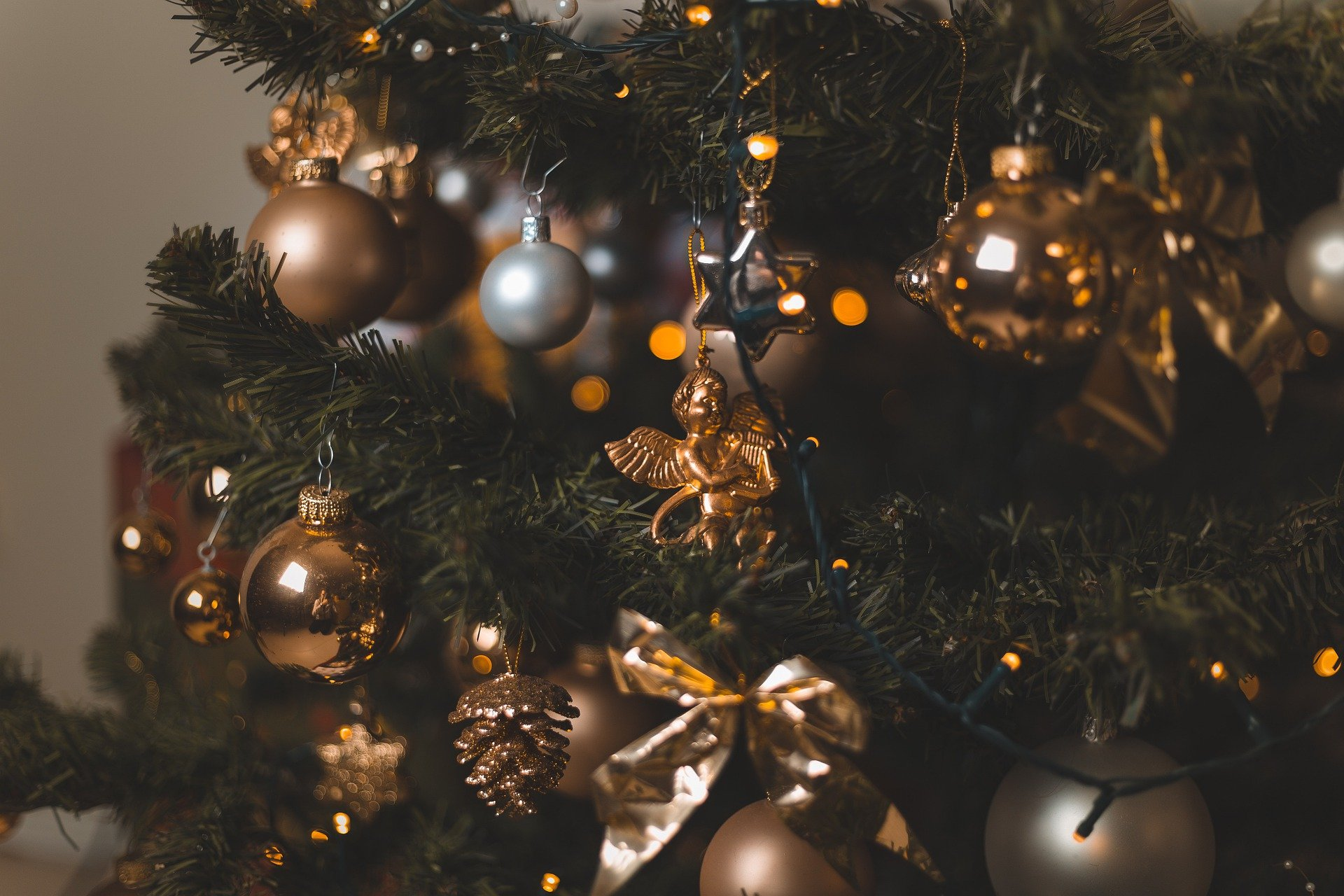 A close-up of a Christmas tree decorated with ornaments. Photo courtesy of captainmk via Pixabay.