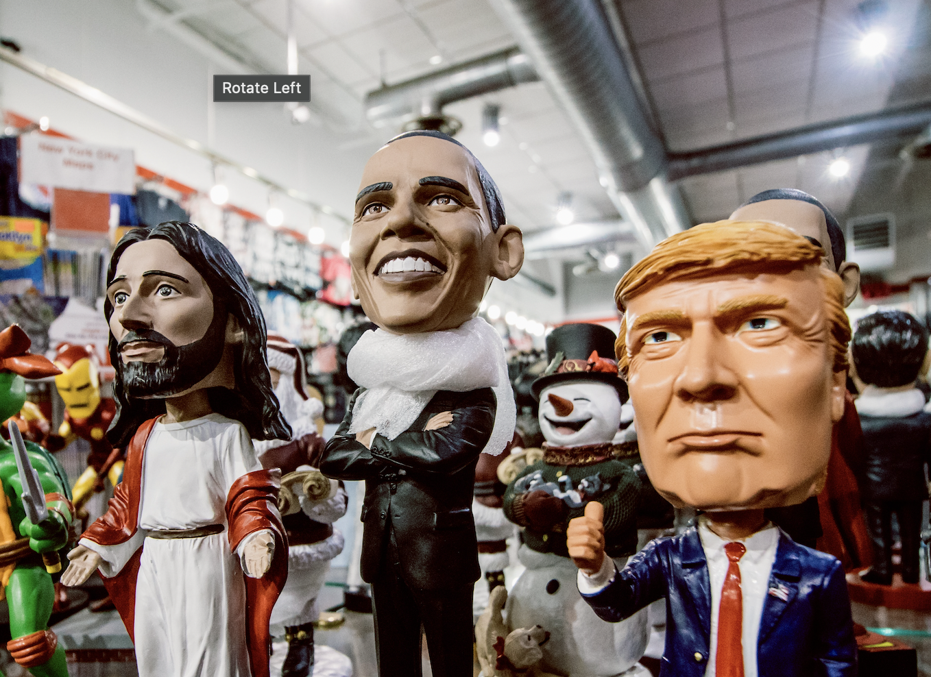 Photo of bobbleheads depicting Jesus Christ, Barack Obama and Donald Trump on display in a novelty gift shop. Image courtesy of Stephen Mayes via Unsplash.