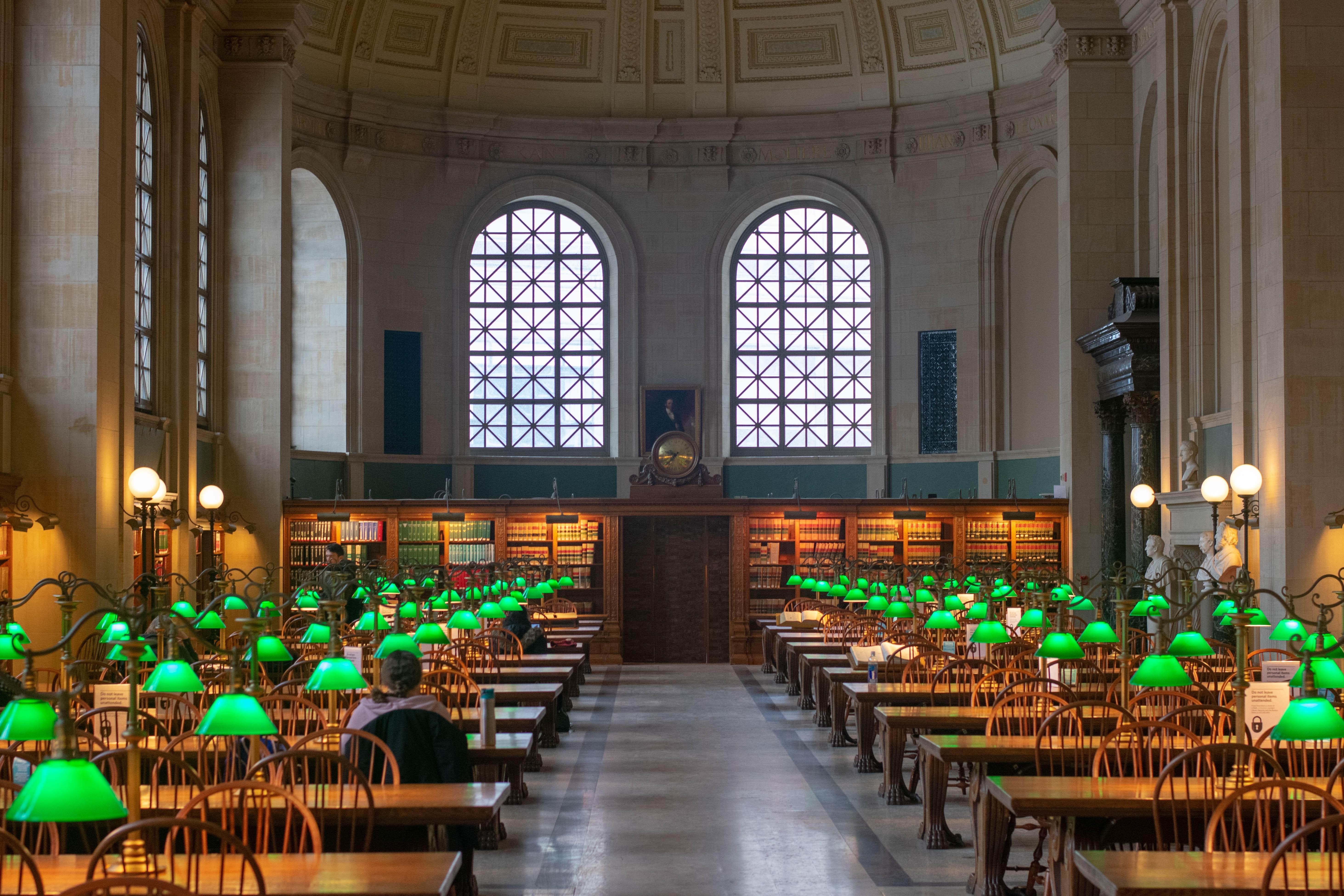 A study room at the Boston Public Library. Photo courtesy of Daniel Brubaker on Unsplash.