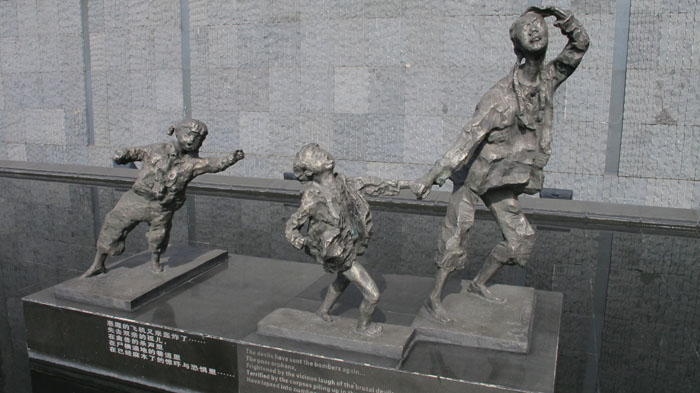 Statues of a woman and young children at the Nanjing Massacre Memorial Hall Monument depicting the fear and violence faced by Chinese civilians during the 1937 massacre. Photo of of Judy Katz via facinghistory.org.