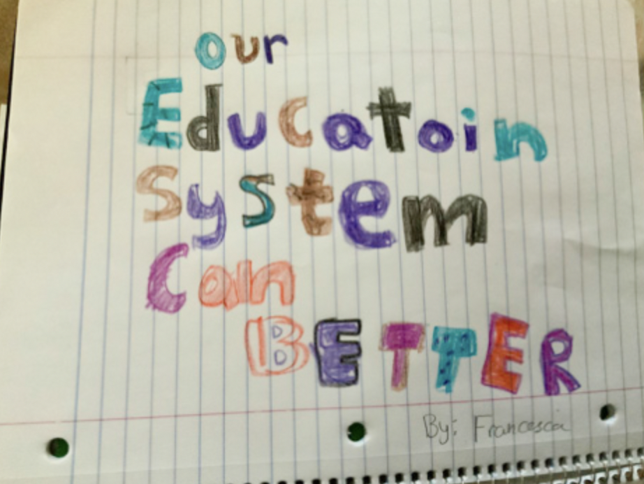 "Image of a message written in multicolor, ""Our education system can [be] better."" Photo courtesy of author, Francesca Attis."