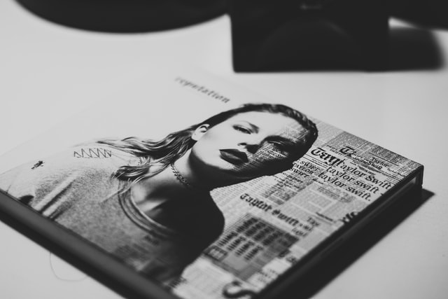 "Black and white photo of ""Reputation"" by Taylor Swift. Photo courtesy of Raphael Lovaski on Unsplash."
