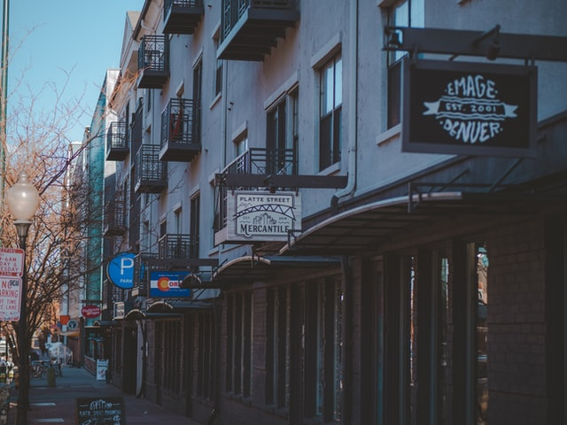 A street lined with local storefronts. Photo courtesy of Mariah Solomon on Unsplash.