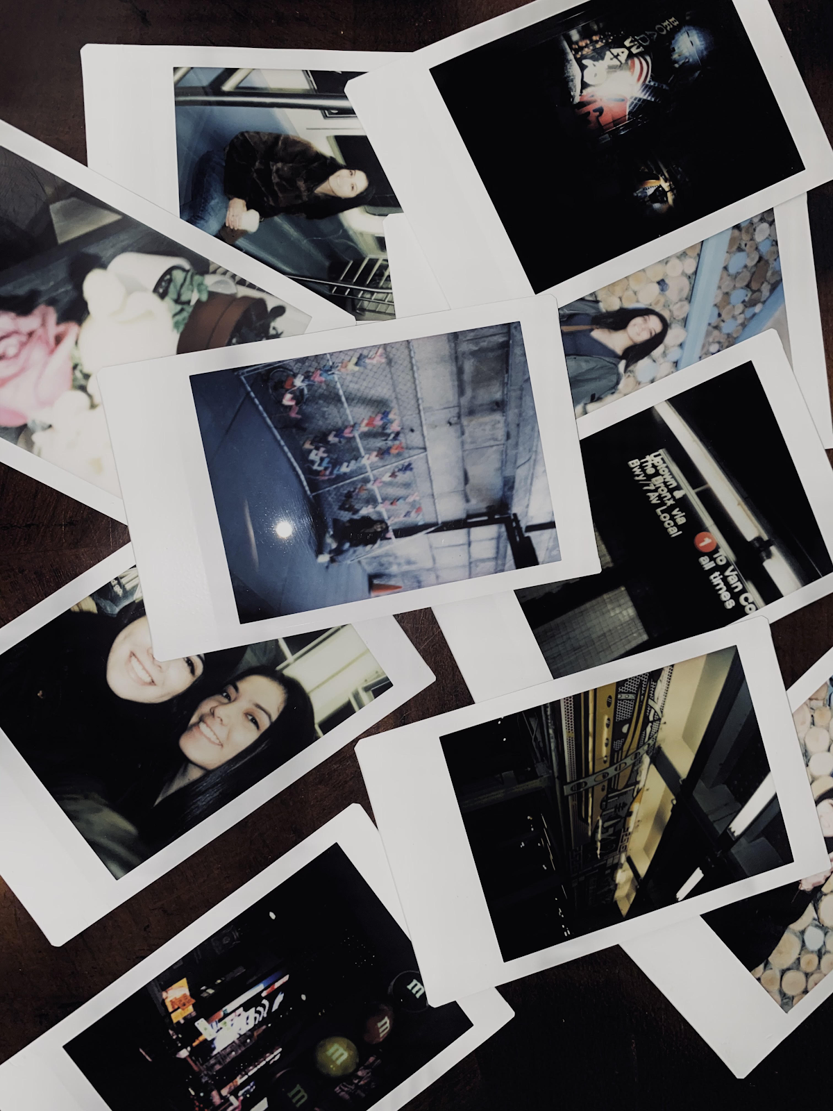 A pile of polaroids featuring the author and various experiences she's had. Photo by Kasandra Wilcox.