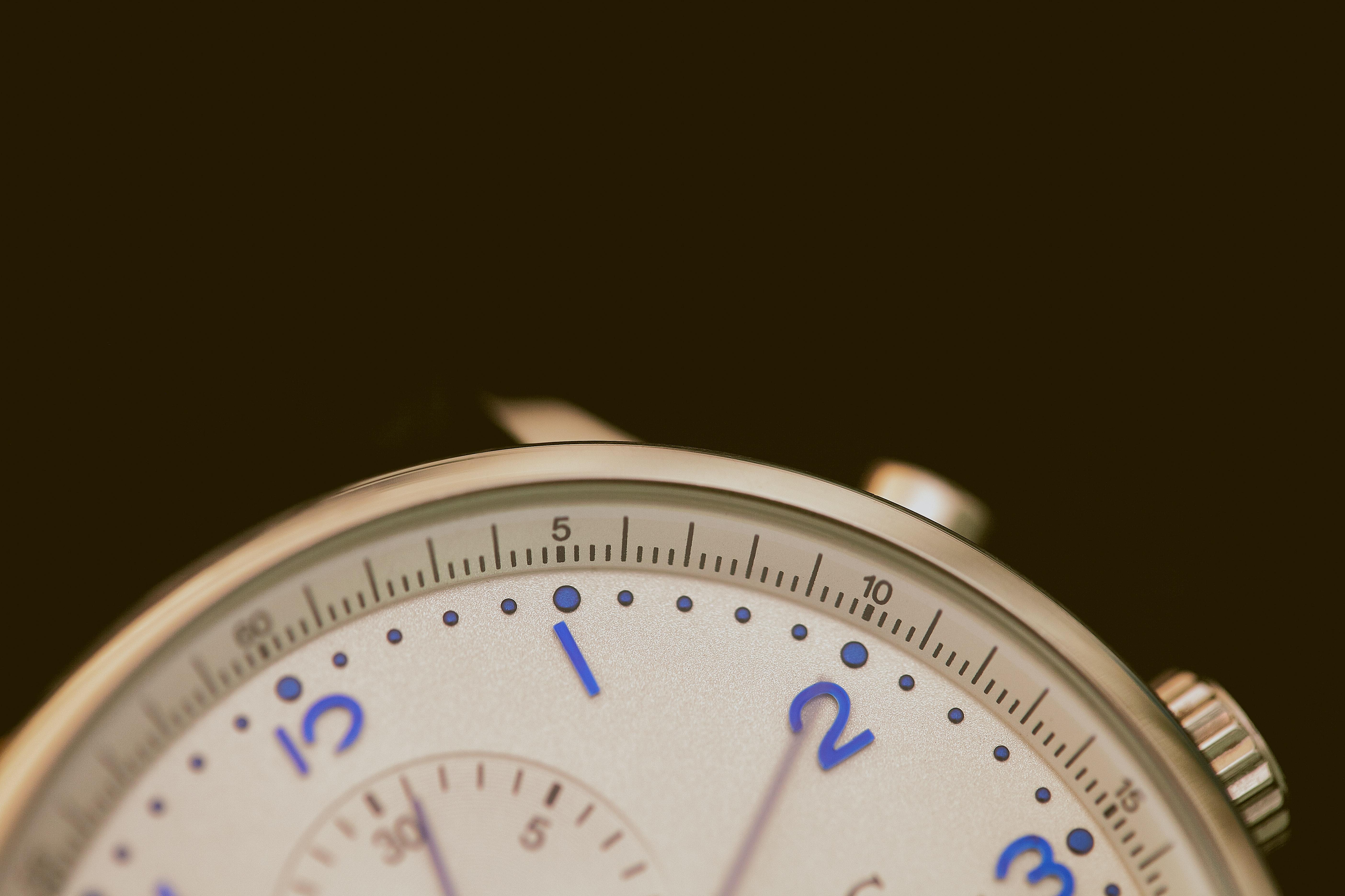 Photo of a close-up image of a watch. Image courtesy of Agê Barros via Unsplash.