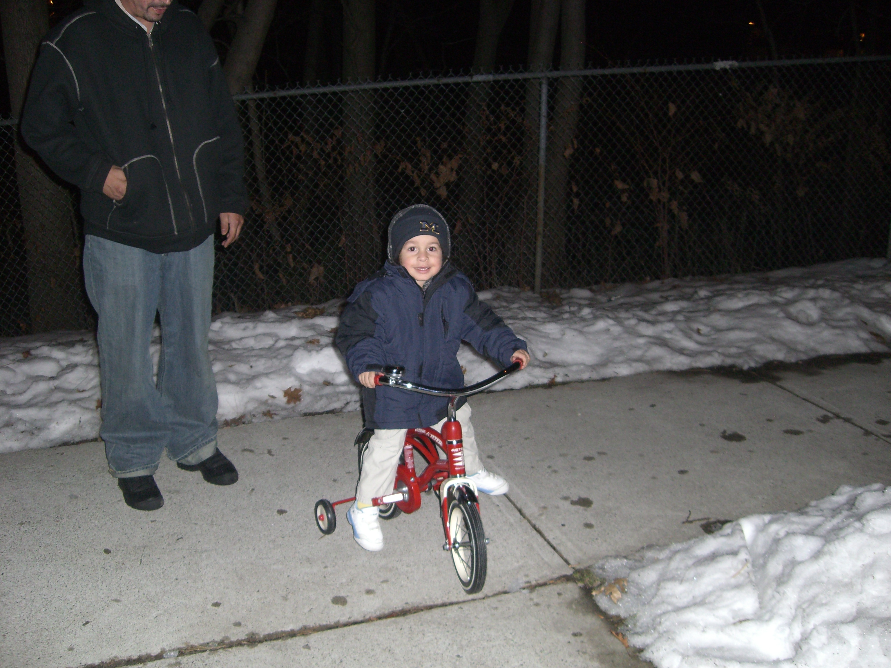 Photo of the author as a child outdoors and riding a tricycle. Photo courtesy of the author.