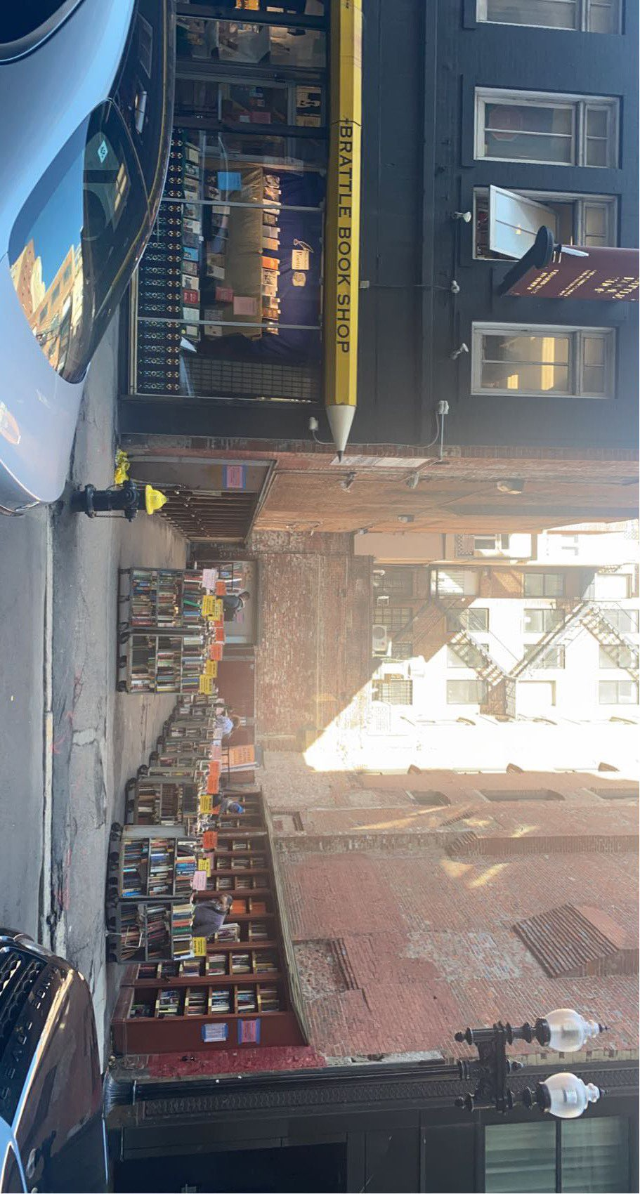 The storefront of Brattle Book Shop and its outdoor space.