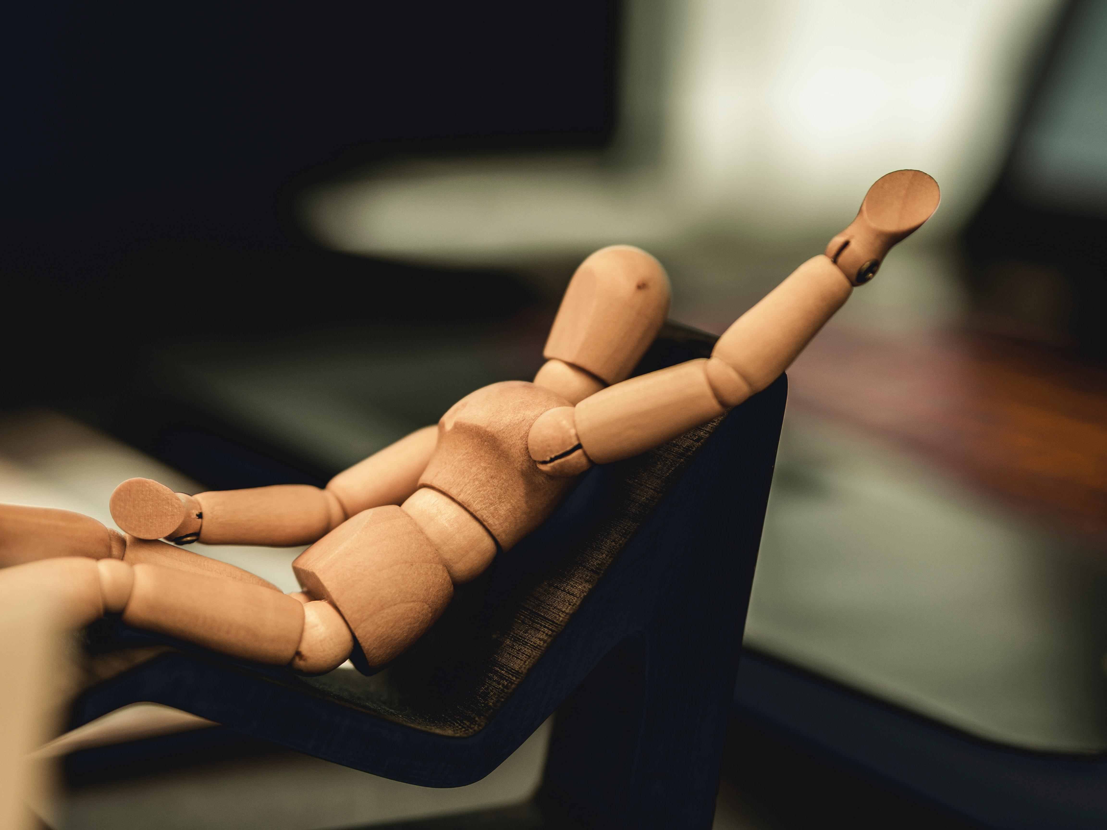 Posing wooden figurine. Photo courtesy of Milan Degraeve on Unsplash.