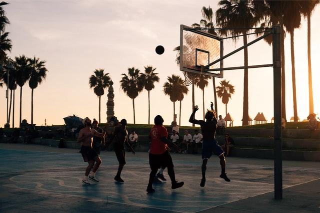 A group of people playing basketball near Venice Beach, CA. Photo courtesy of Ashwin Vaswani on Unsplash.