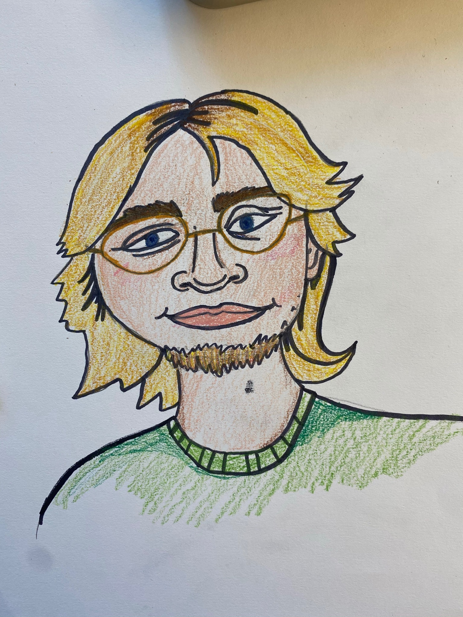 A drawing of the author, who has long blonde hair, glasses, and a beard. Photo courtesy of the author.