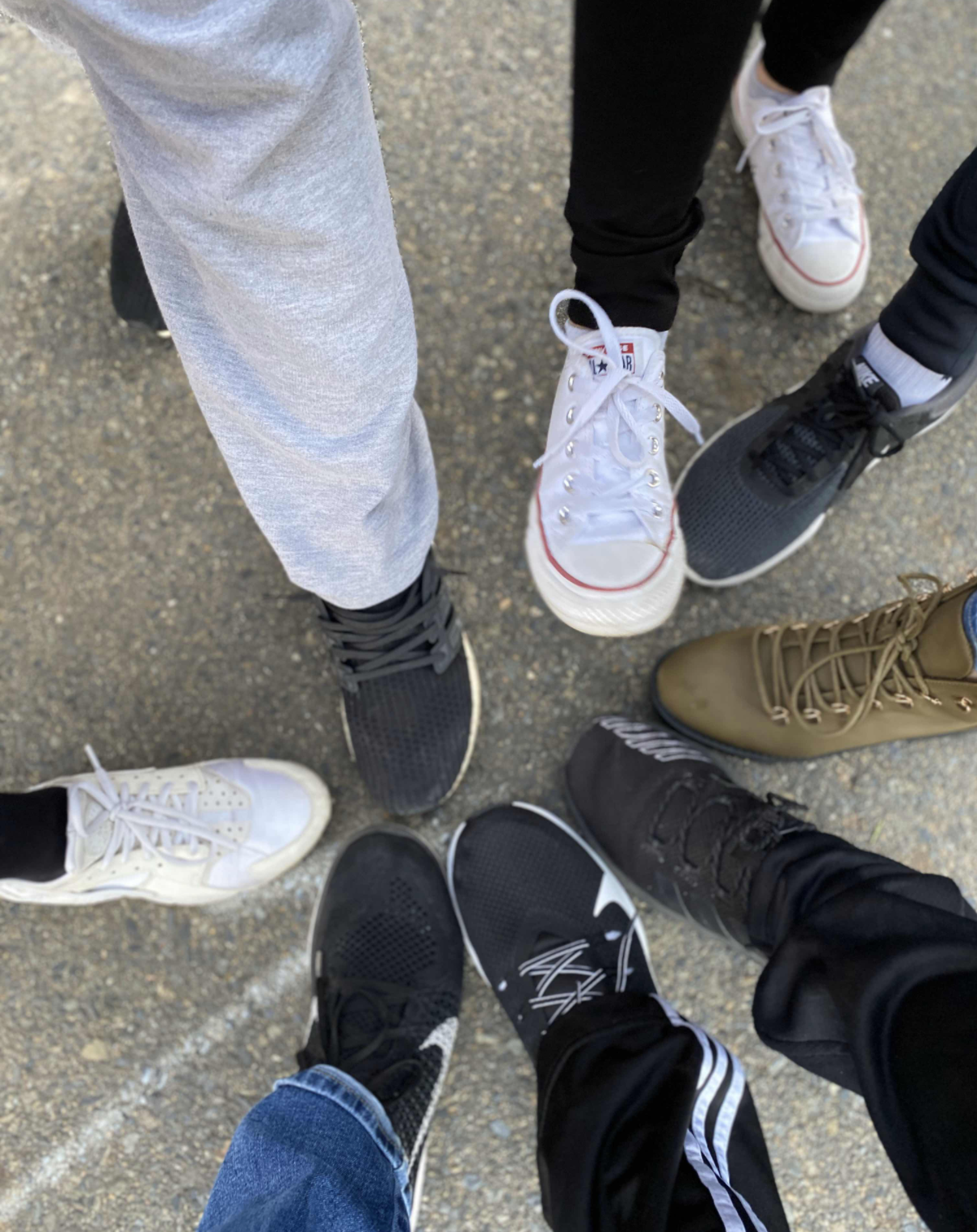 The author and their friends' sneakers in a circle together. Photo taken by the author.