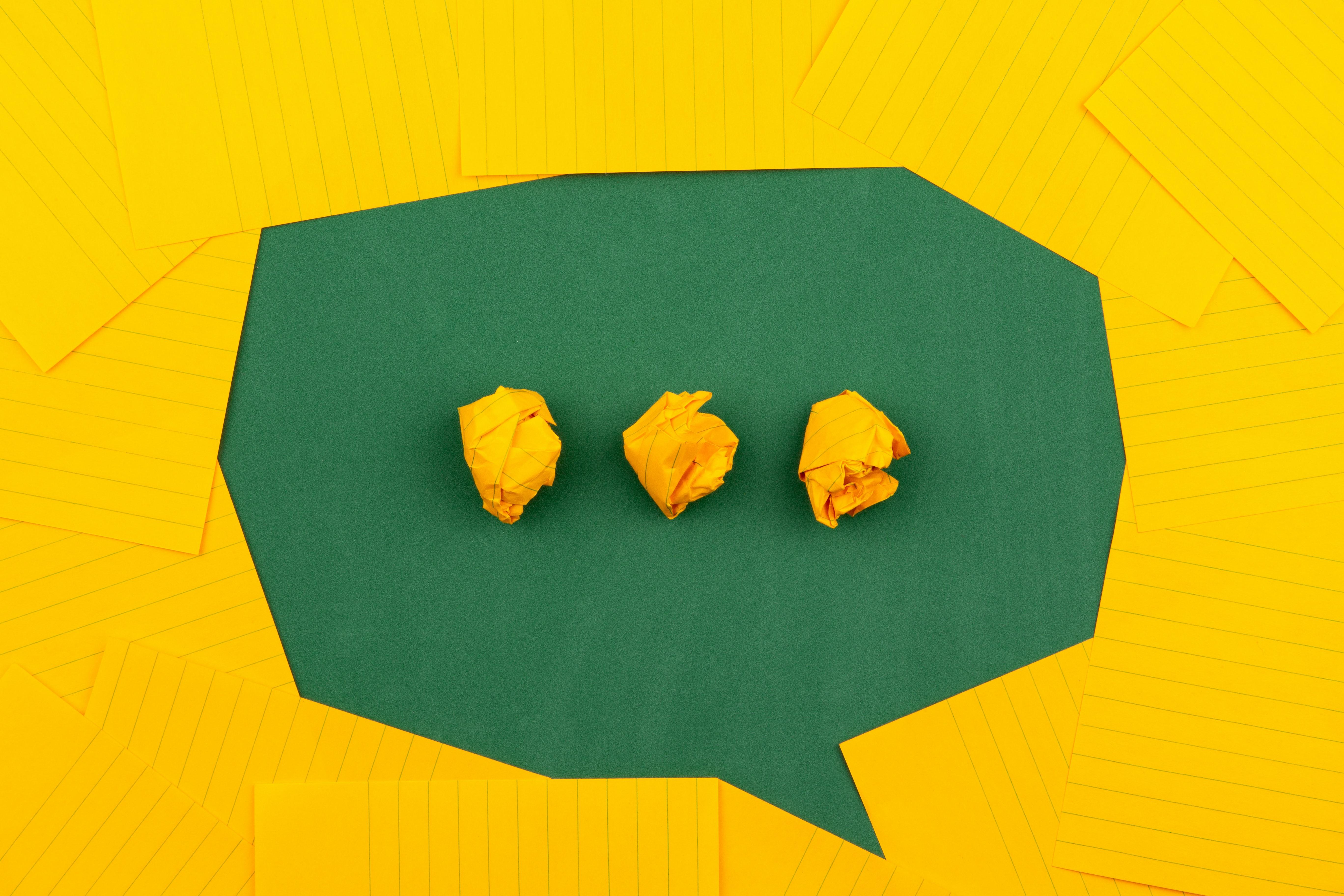 Speech bubble made of yellow paper. Photo courtesy of Volodymyr Hyrshchenko on Unsplash.