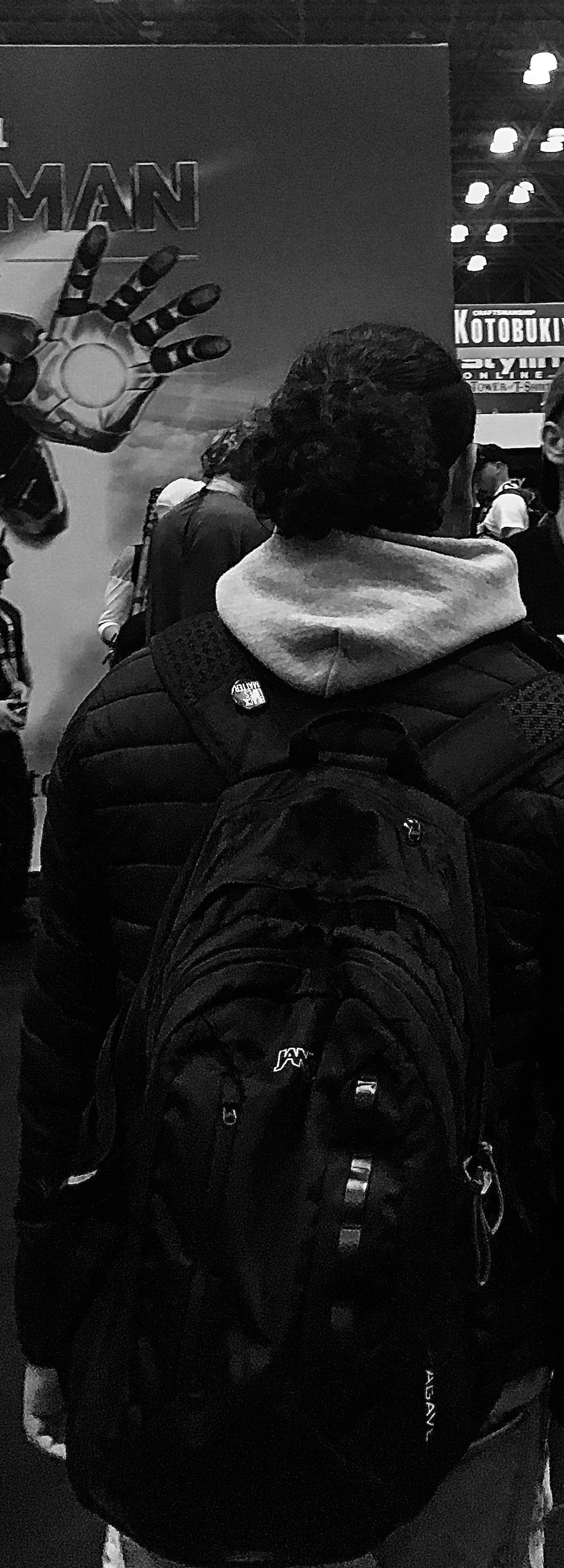 Black and white photo of the author from behind, wearing a ponytail and a backpack. Photo courtesy of the author.