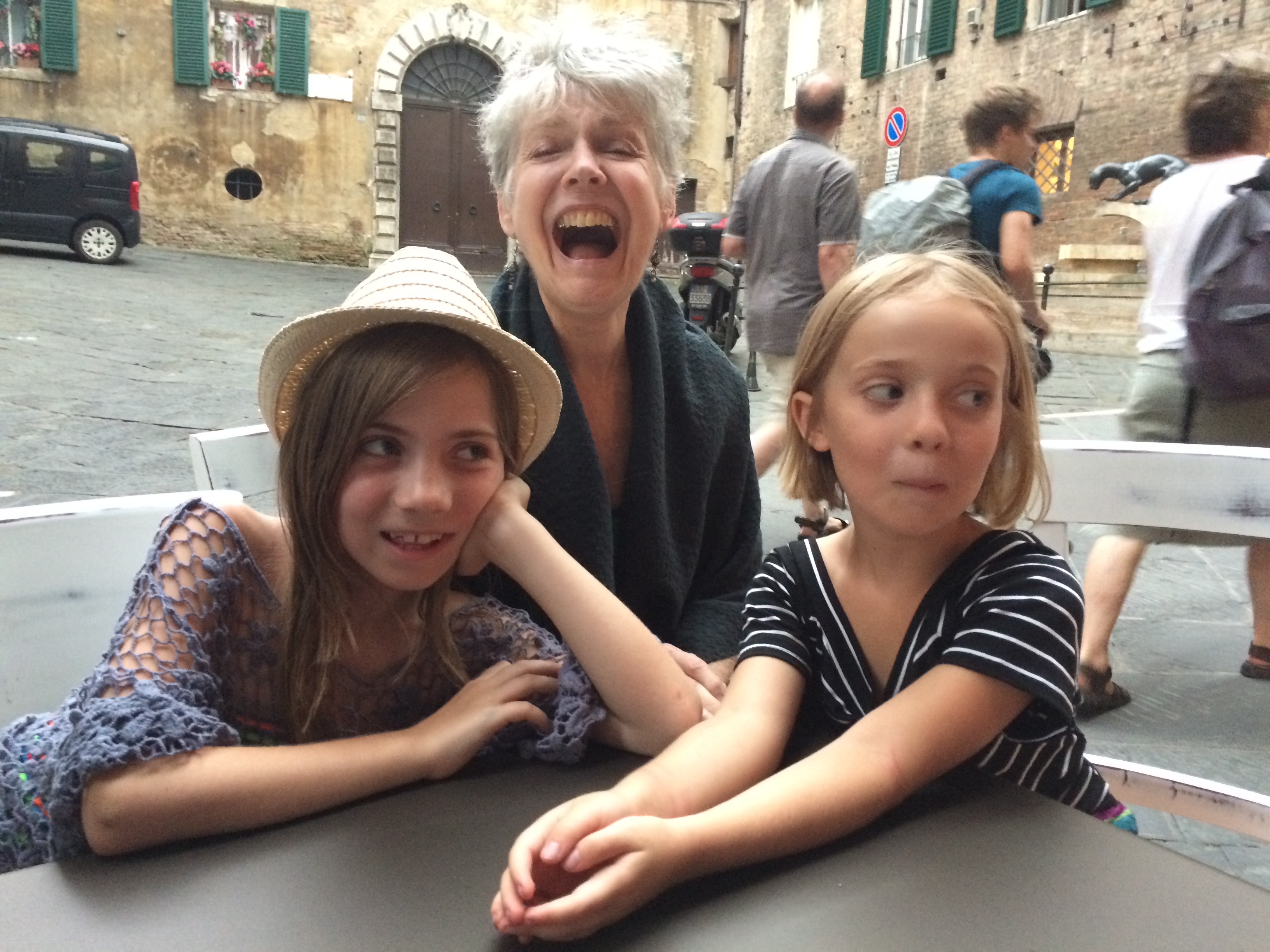 Photo of the author, her sibling, and her grandmother. Photo courtesy of the author.