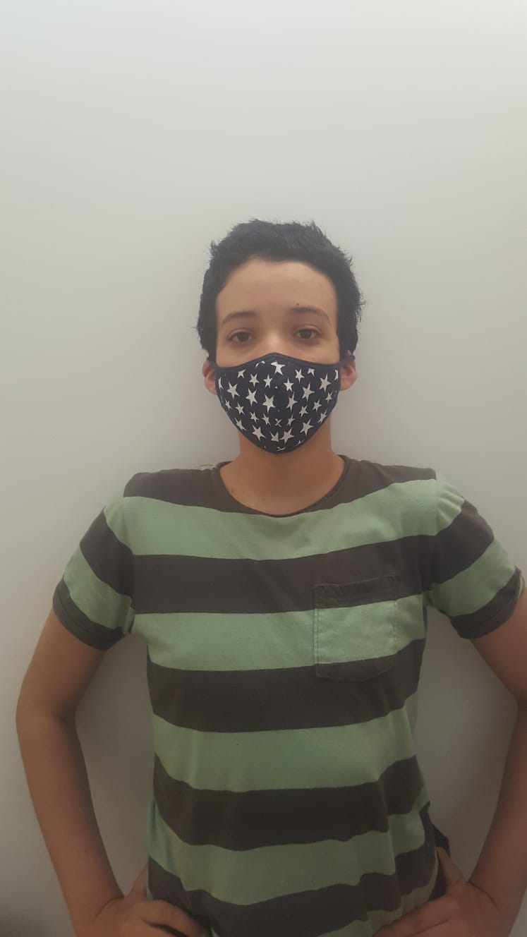 Photo of the author wearing a cloth face mask with stars on it. Photo courtesy of the author.