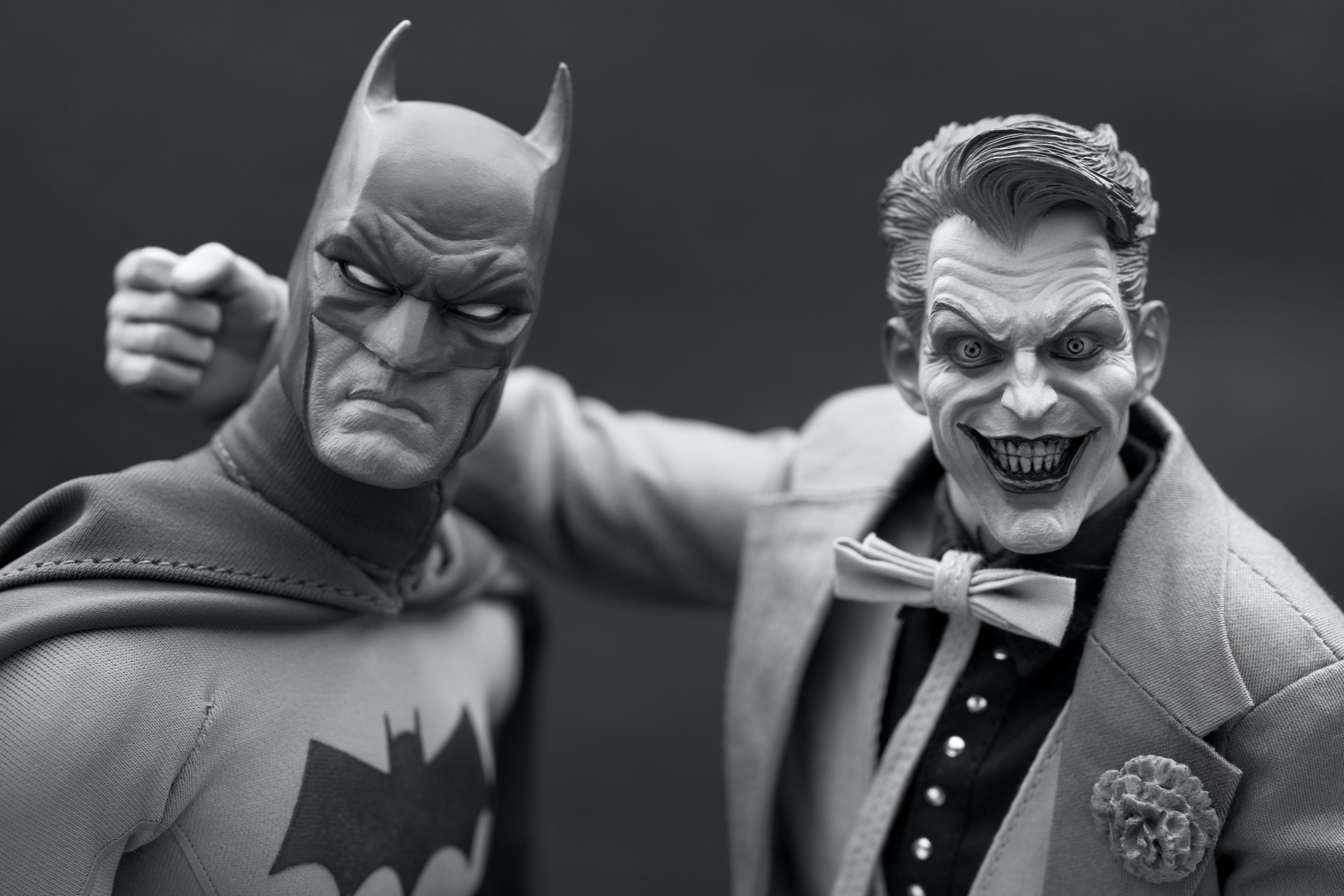 Two side-by-side figurines of Batman and the Joker. Photo courtesy of Patrick Collins on Unsplash.