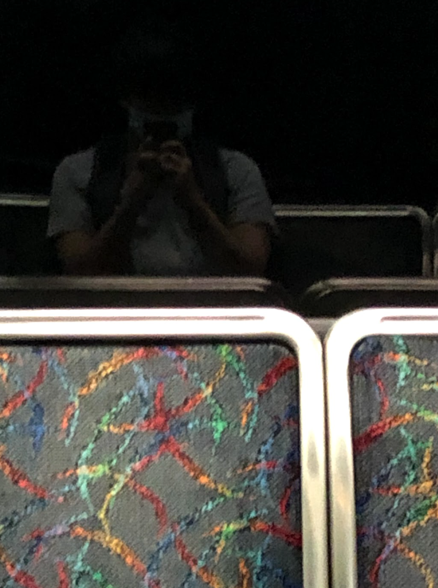 Selfie from the author wearing a face mask on the MBTA. Photo taken by the author.