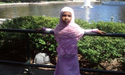 Photo of the author as a child wearing a pink hijab. Photo courtesy of the author.