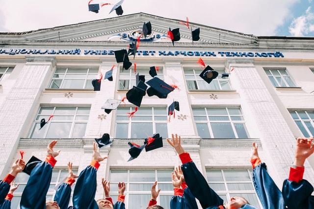 Graduates throwing their caps in the air. Photo courtesy of Vasily Koloda on Unsplash.