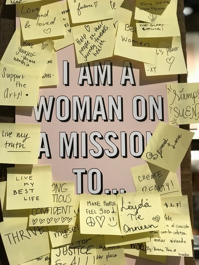 """A sign reads """"I am a woman with a mission to..."""" surrounded by sticky notes of answers. Photo courtesy of Valentina Conde on Unsplash."""