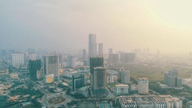 Afternoon fog over the Hanoi, Vietnam skyline. Photo courtesy of Anz Design on Unsplash.