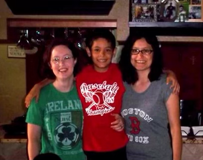 Family photo of the author with his arms wrapped around both his mothers. Photo courtesy of the author.