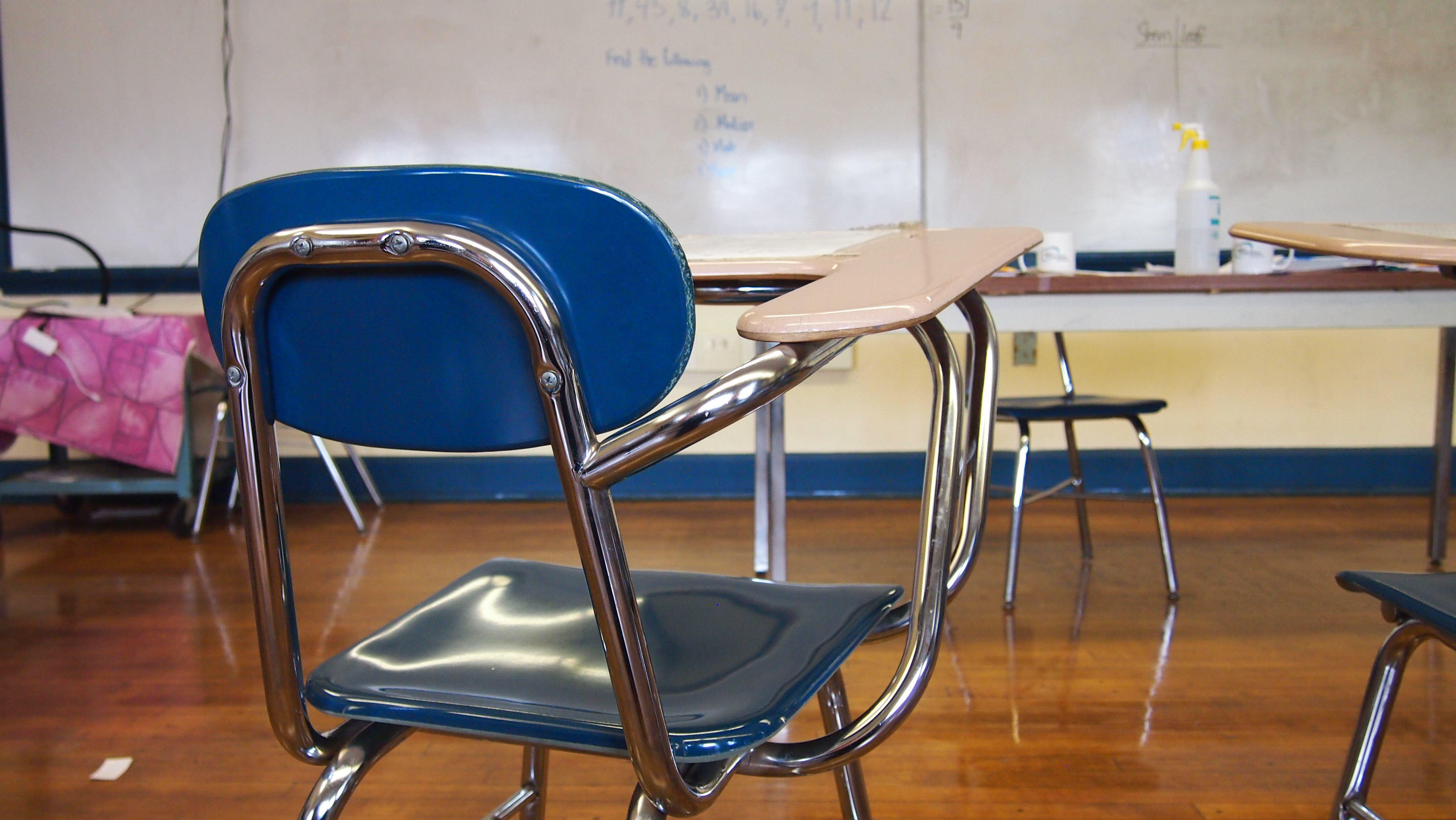 Photo of a desk facing the front of a classroom. Photo courtesy of Teens in Print.