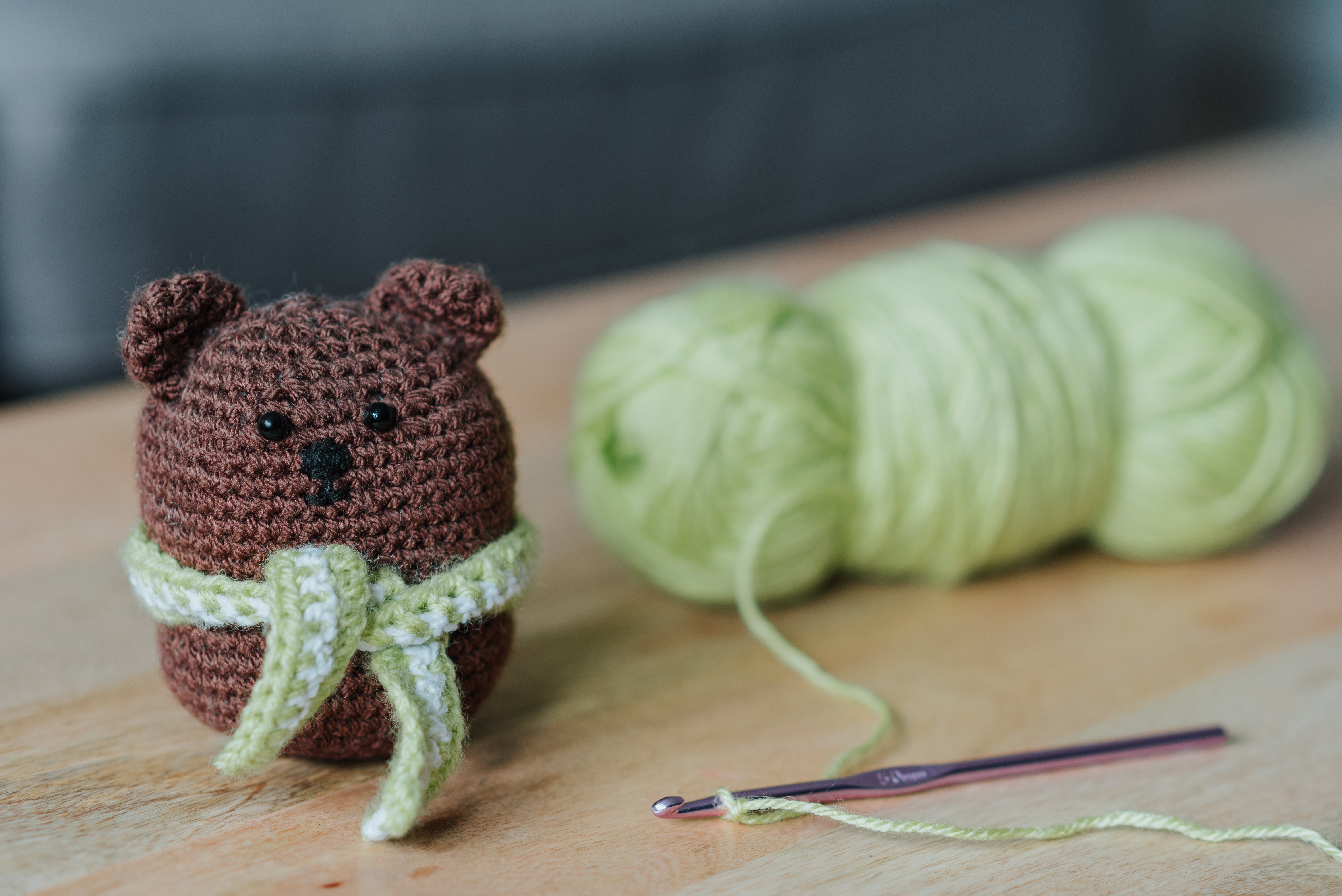 Photo of a crochet bear and crocheting supplies. Photo courtesy of Anete Lusina on Pexels.