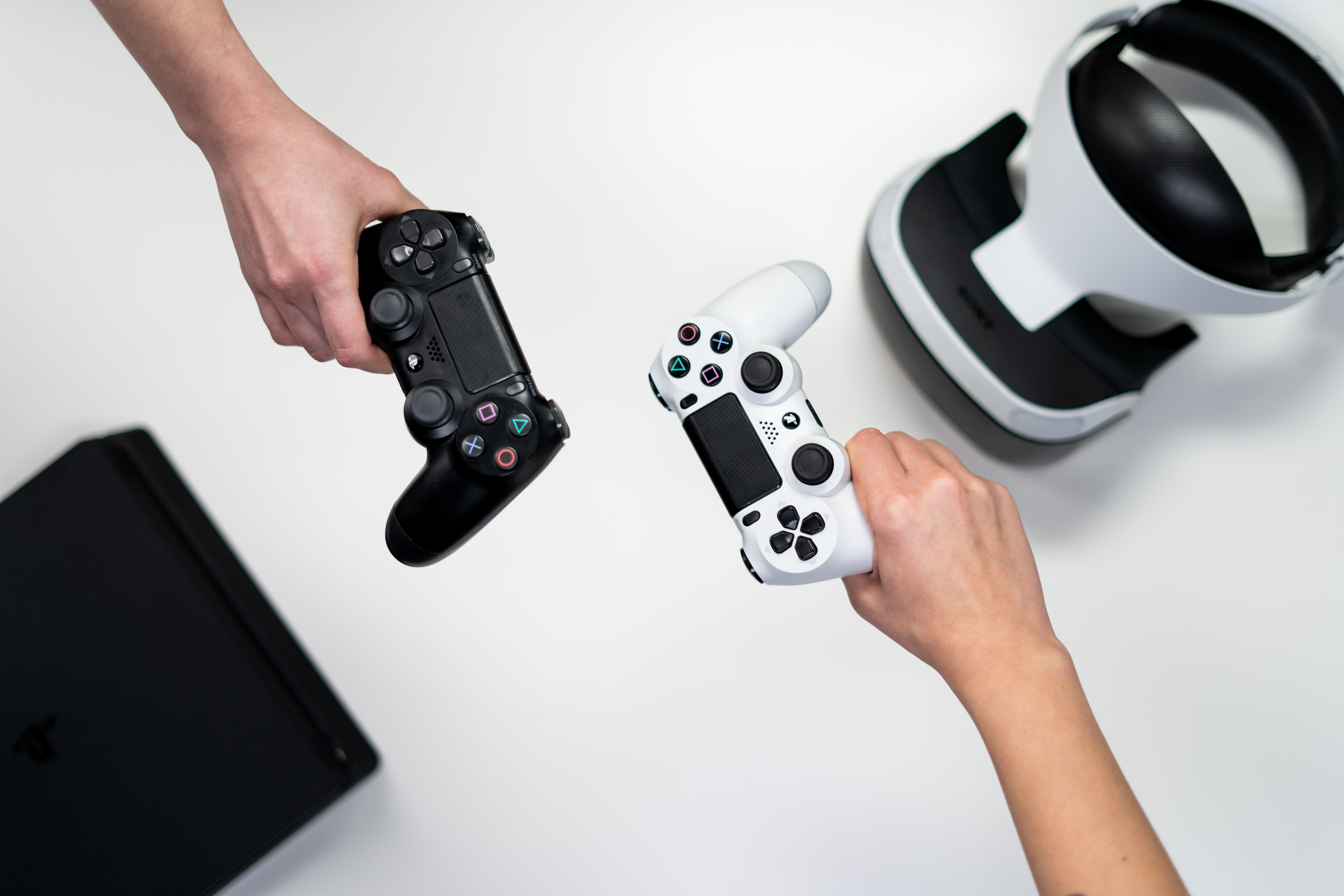 Photo of two video game controllers courtesy of Pexel.