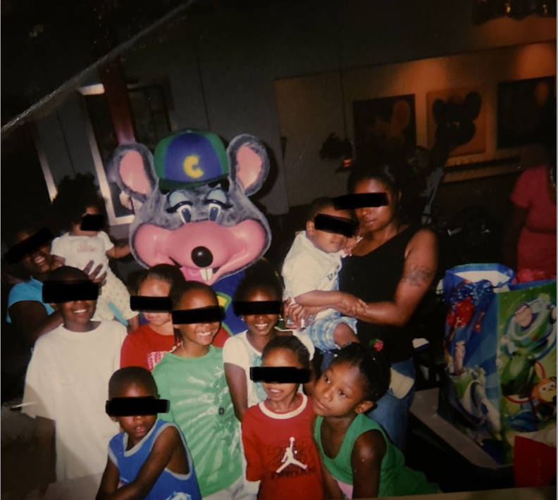 Photo of the author and their family at Chuck E. Cheese. Photo courtesy of the author.