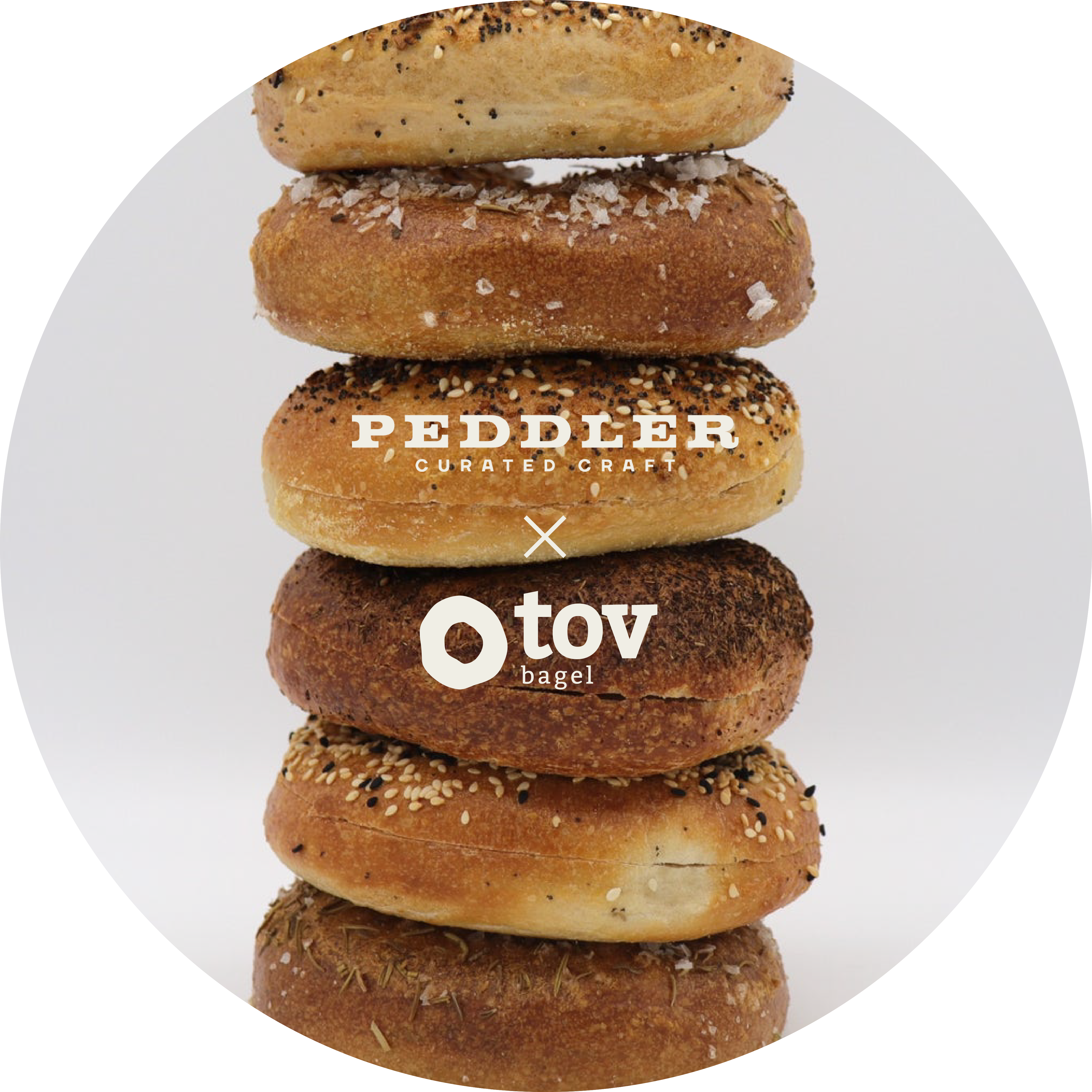 A stack of bagels with the Peddler & Tov logos