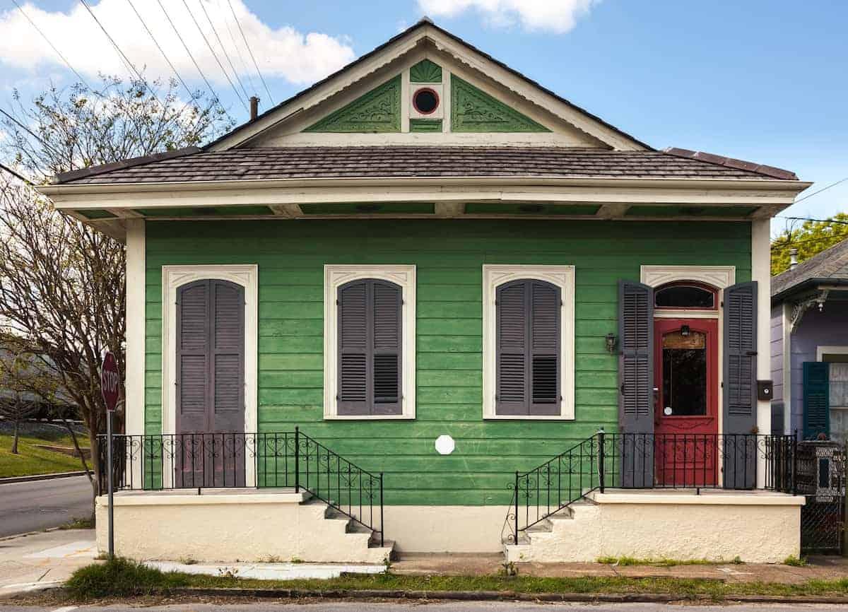 Green duplex with a red door