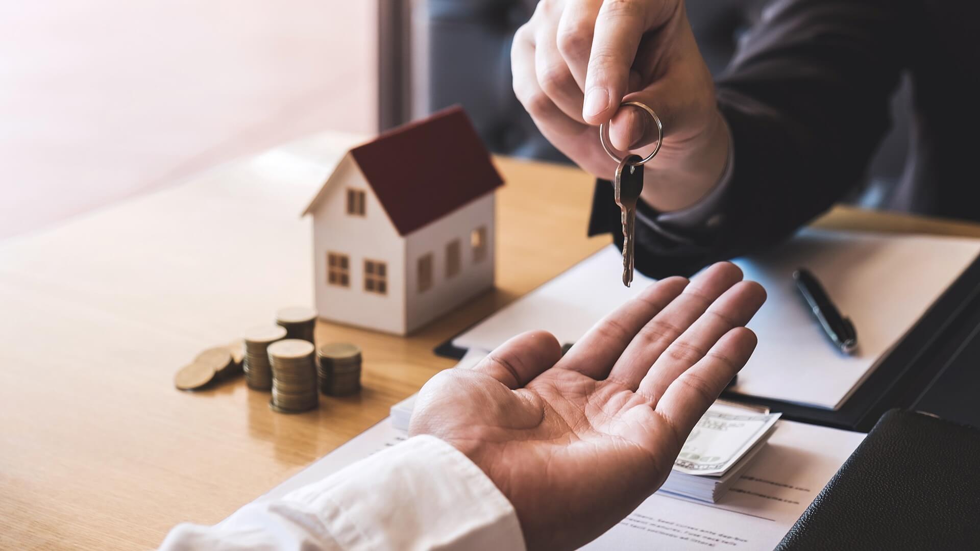 landlord handing keys to tenant