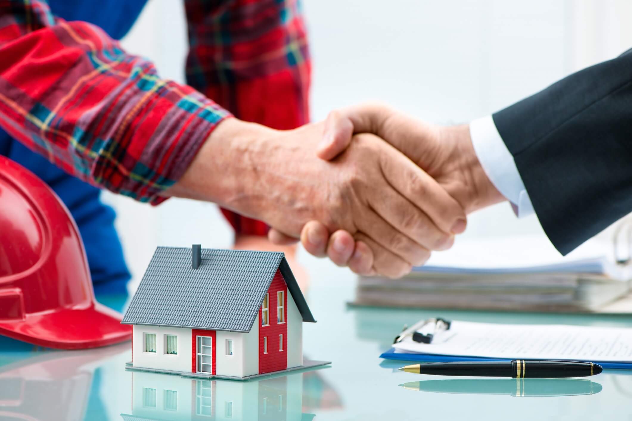 Wholesaler and buyer shaking hands for a property purchase agreement