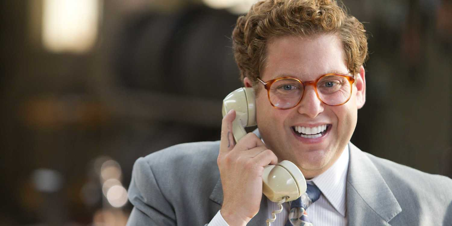 Jonah hill in The Wolf of Wallstreet cold calling while smiling