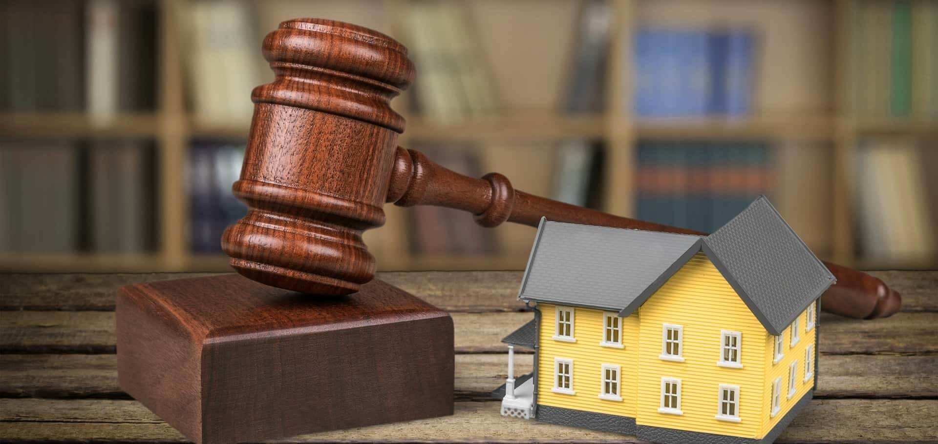 Real estate law with a hammer and a home
