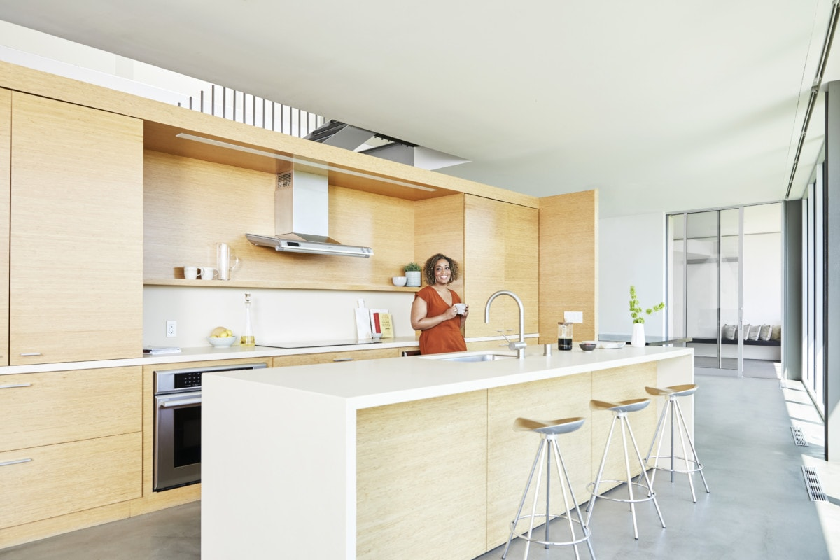 Woman in remodeled kitchen