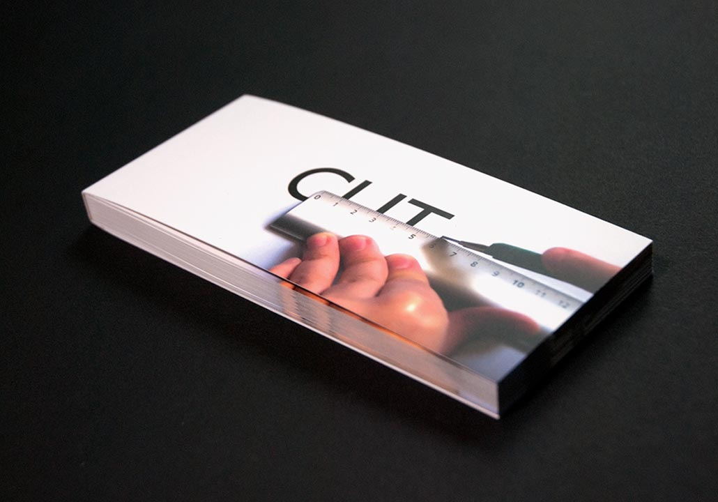Thumbnail image for the Flip Book project, representing the closed flip book on a black background. The cover shows cropped hands holding a ruler and a cutter, cutting the word CUT, written in large black letters.