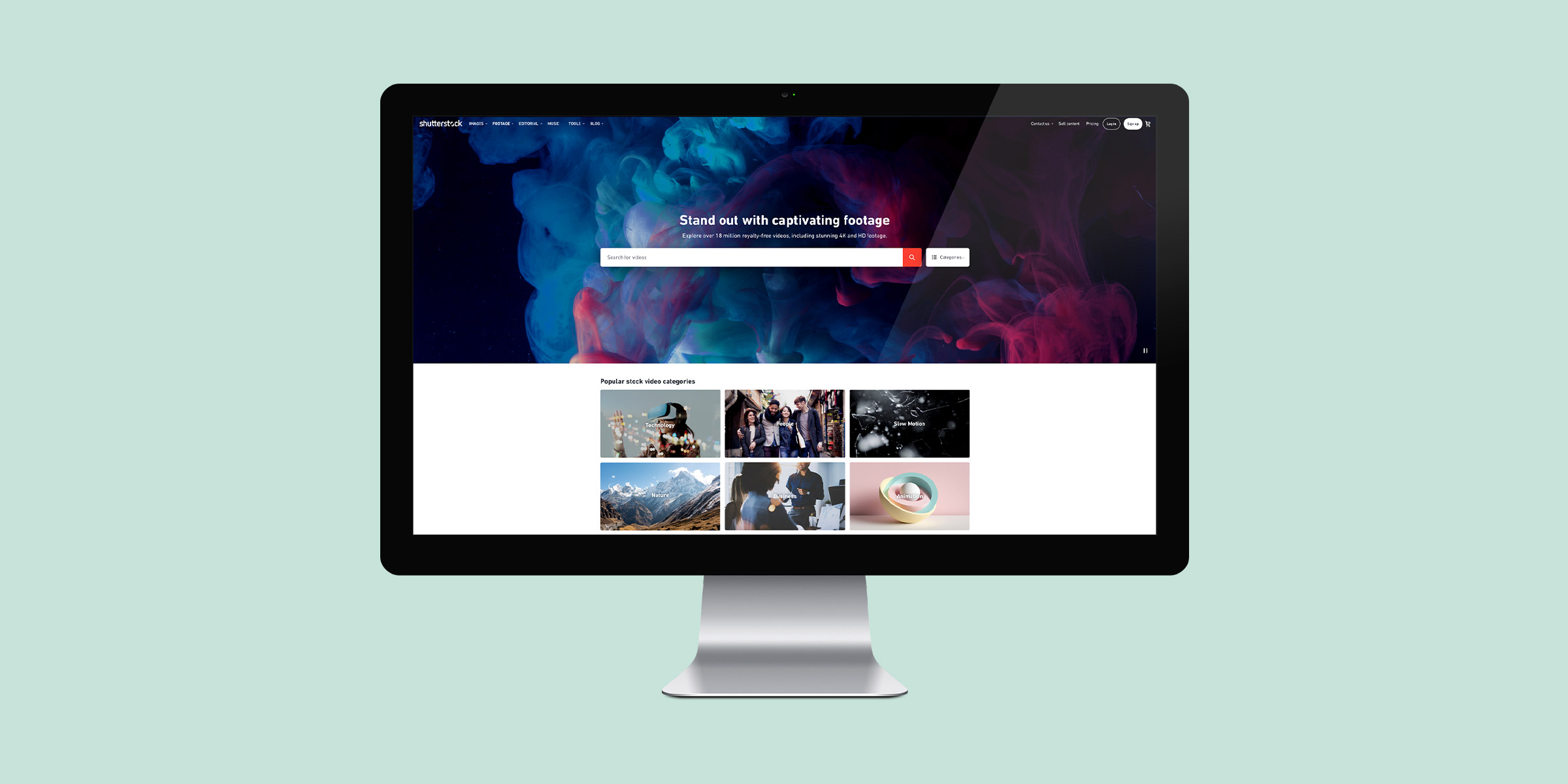 Header image for the Shutterstock Footage project, representing an iMac display on a pale green background, with the website homepage on screen.