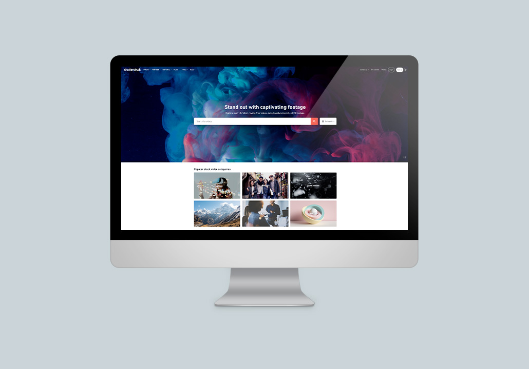 Thumbnail image for the Shutterstock Footage project, representing an iMac display on a blue-grey background, with the website homepage on screen.
