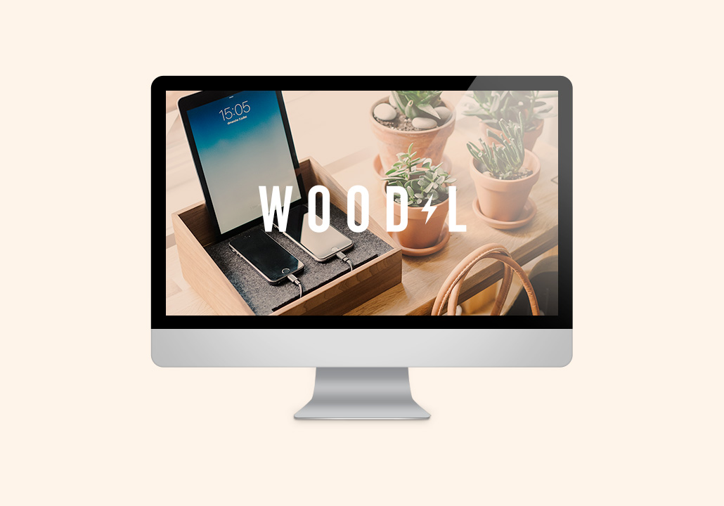 Thumbnail image for the WoodL project, representing an iMac display on a pale peach background, with the website homepage on screen.