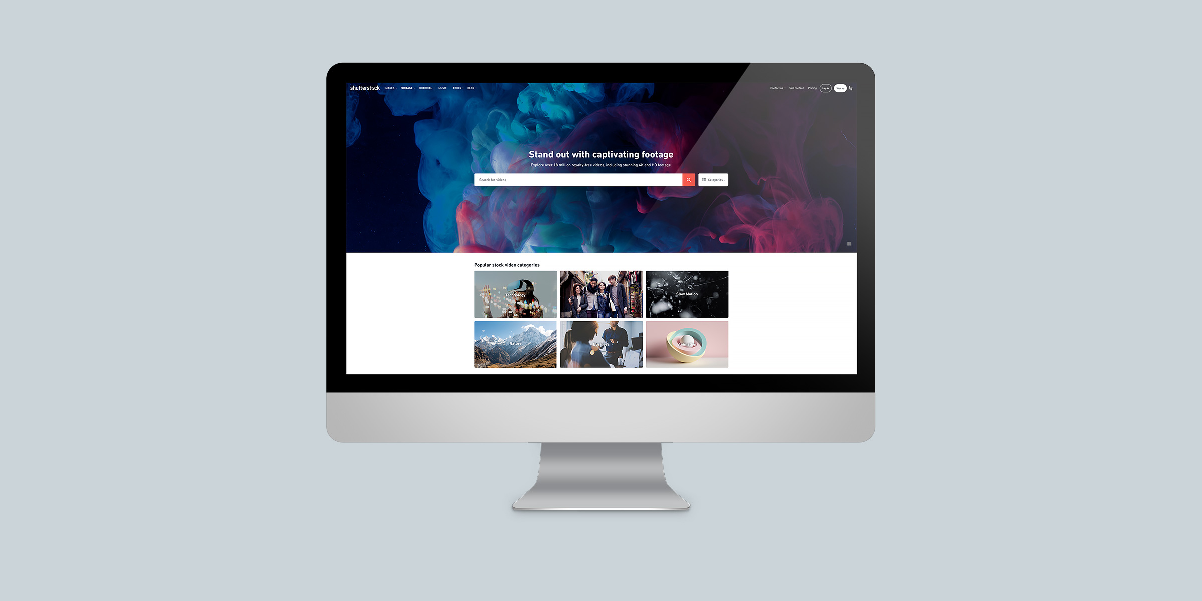 Header image for the Shutterstock Footage project, representing an iMac display on a blue-grey background, with the website homepage on screen.